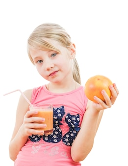 Girl in pink holds a smoothie of grapefruit