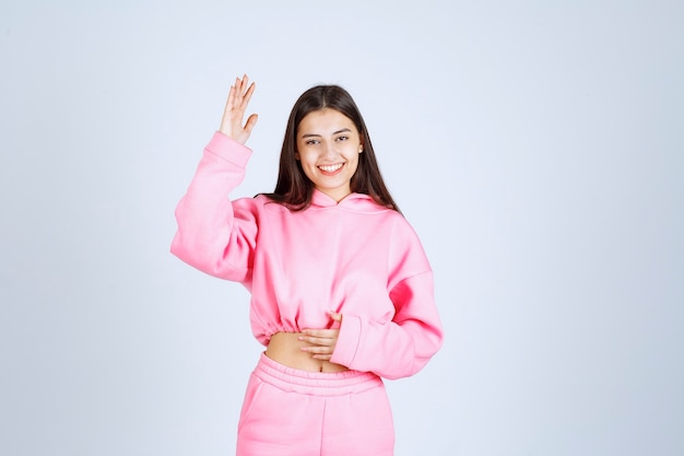 Girl in pink pajamas giving happy and seductive poses