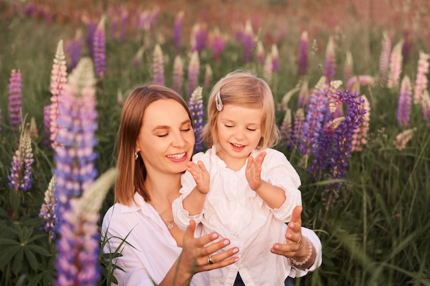 Girl play with mummy on nature