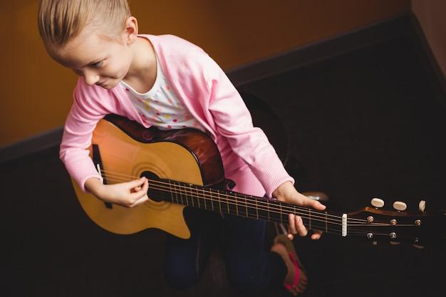 Girl playing the guitar