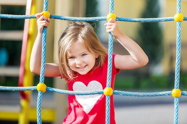 Girl playing on playground in city park