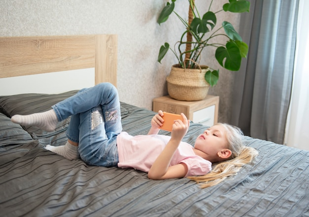 Girl playing on smartphone
