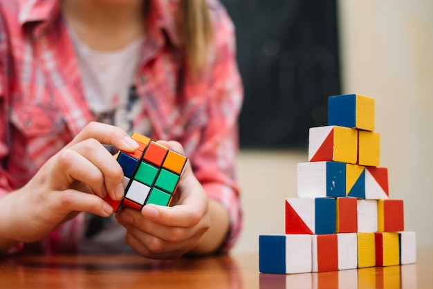Girl playing with cube puzzle