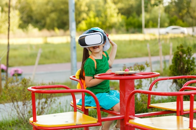Girl playing with virtual reality goggles