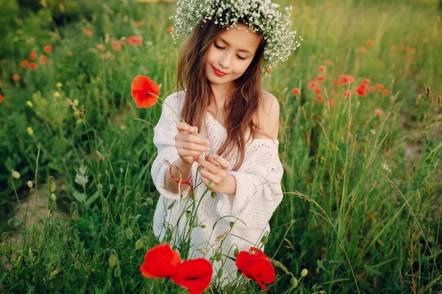 Girl plucking a red flower