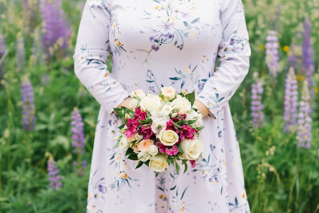 Girl plus size is holding a bouquet of flowers