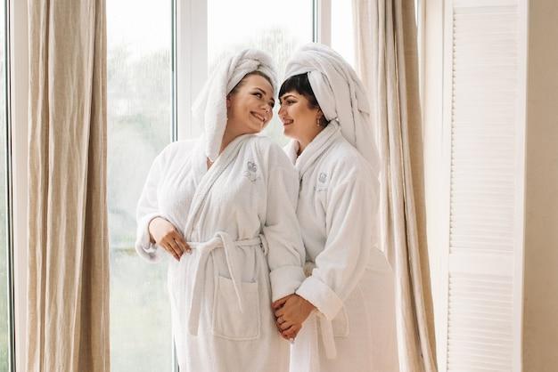 Girl plus size in robe and turban spa smile family day