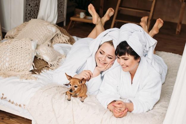 Girl plus size in robe and turban spa smile spa family day