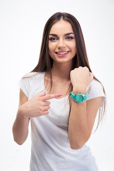 Girl pointing finger at her watch