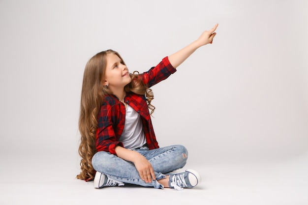 Girl pointing with her finger to copyspace