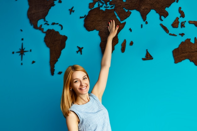 Girl points to a world map