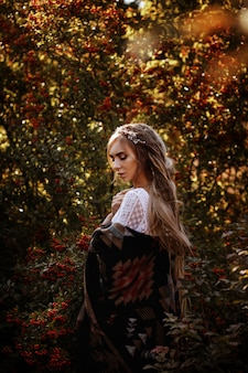 Girl in poncho at sunset in a rowan