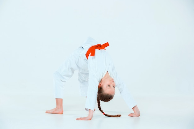Girl posing at aikido training in martial arts school. healthy lifestyle and sports concept
