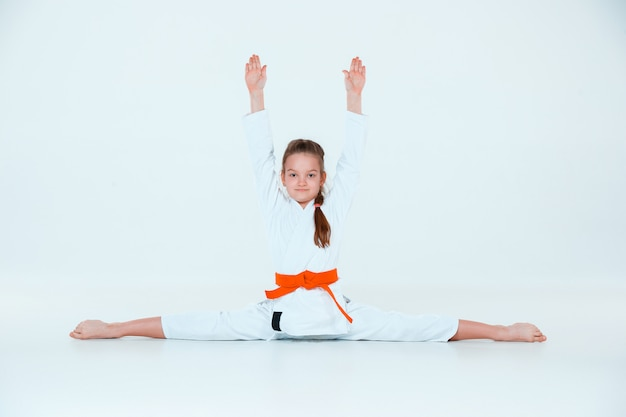 The girl posing at aikido training in martial arts school. healthy lifestyle and sports concept