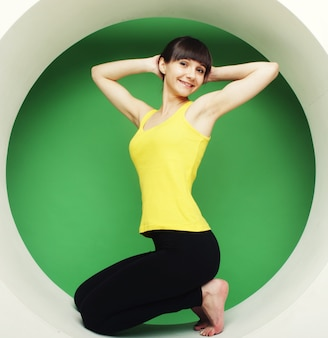 Girl posing in green circle