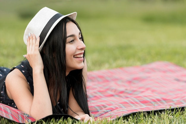 Girl posing on a picnic blanket