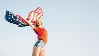 Girl posing with american flag