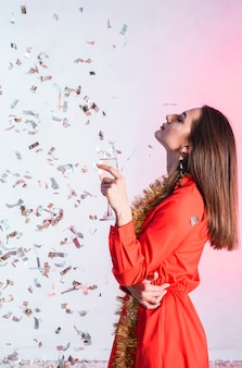 Girl posing with confetti at a new year party