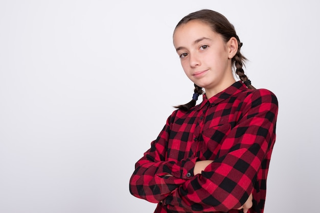 Girl posing with crossed arms and a very nice hairstyle