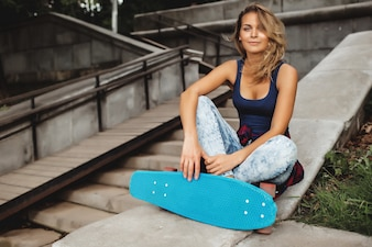 Girl posing with skate board