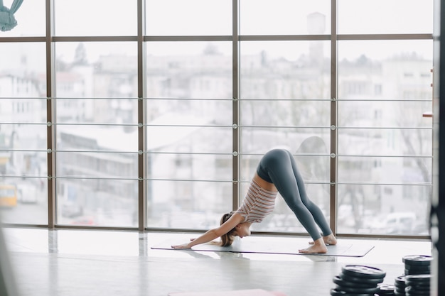 Girl practice yoga, sports and healthy lifestyles, the concept of mental balance