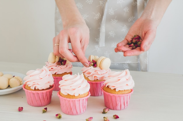 Girl prepares cupcakes