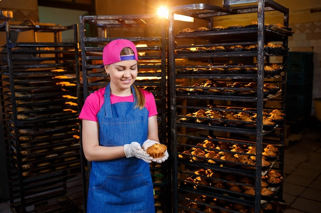 Girl preparing cookies, in a small bakery, family business, authentic, hobby, mood, comfortable. caring and love