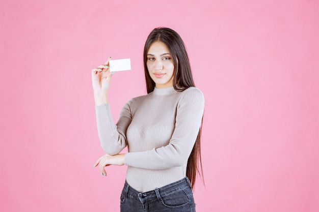 Girl presenting her business card to a business partner