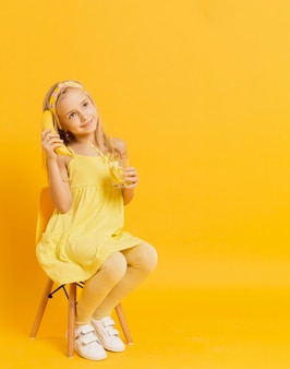 Girl pretending banana is a telephone while posing