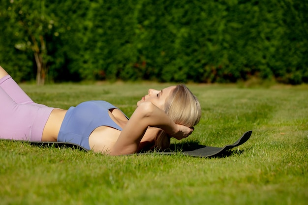 Girl pump abs in the backyard of her house in summer