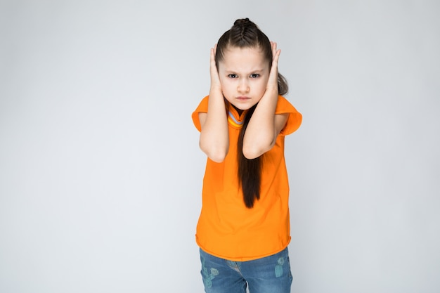 Girl put her hands over her ears.