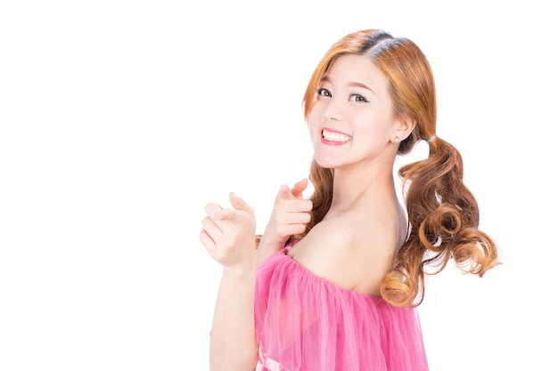 The girl raised her hand, pointing forward on white background.