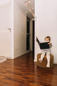 Girl reading in stylish room
