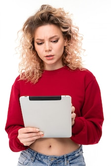 Girl reads messages on tablet on white