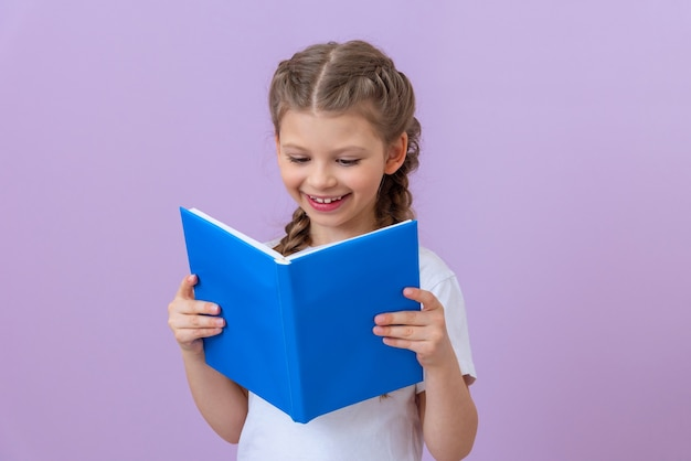 The girl really likes to read an interesting book.