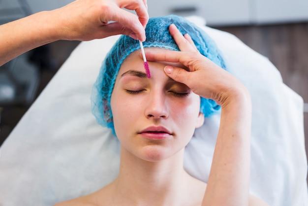 Girl receiving facial treatment in a beauty salon