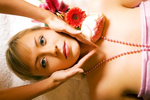 Girl receiving a head massage