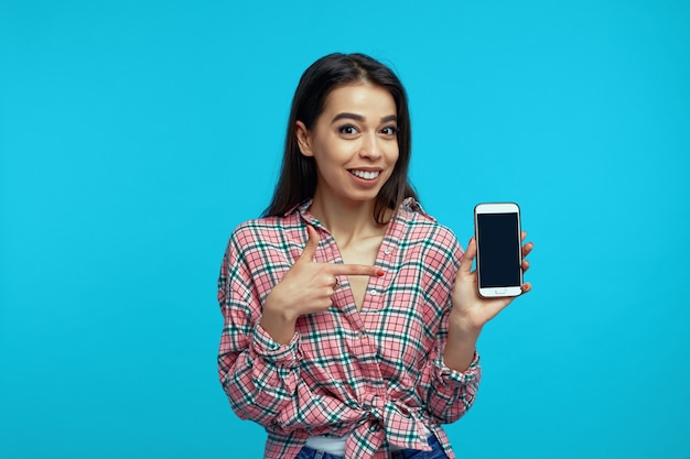 Girl recommends device or app points at mockup screen of smartphone