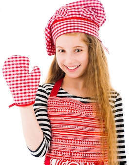 Girl in red apron and baking glove
