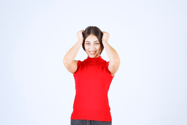 Girl in red shirt giving neutral, positive and appealing poses.