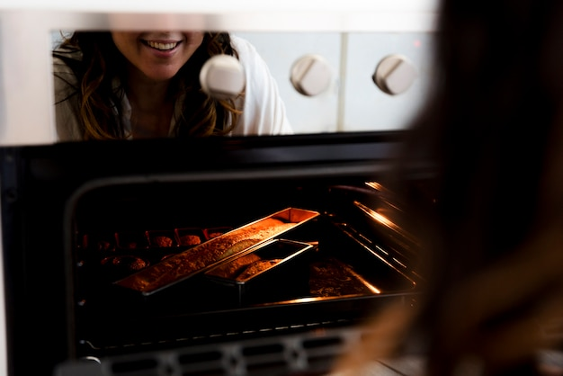 Girl reflected on the oven