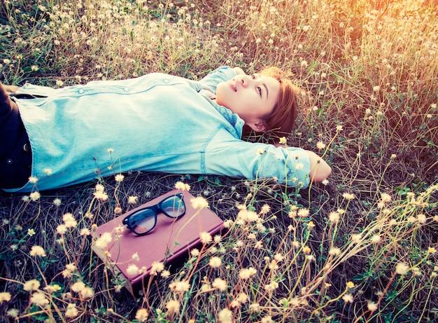 Girl resting lying among flowers