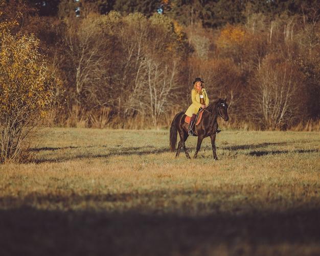 Girl ride a horse