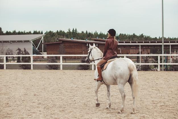 The girl rides a horse