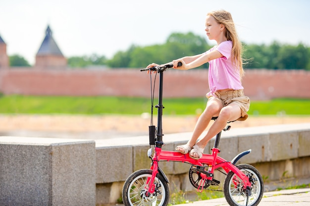 Girl riding at novgorod kremlin at volkhov river