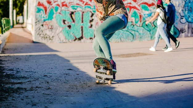 Girl riding skateboard making stunts