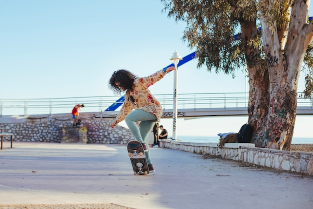 Girl riding skateboard making tricks