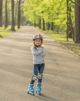 Girl roller blading, arms crossed on chest