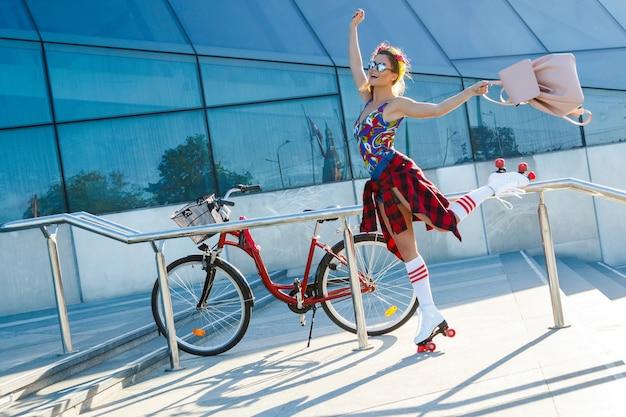 Girl on the roller-skate in the city