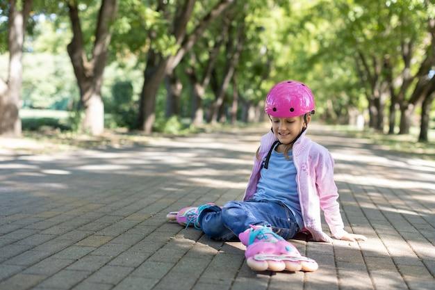Girl on roller skates in the park